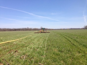 Farm machinery injecting manure in orderly rows